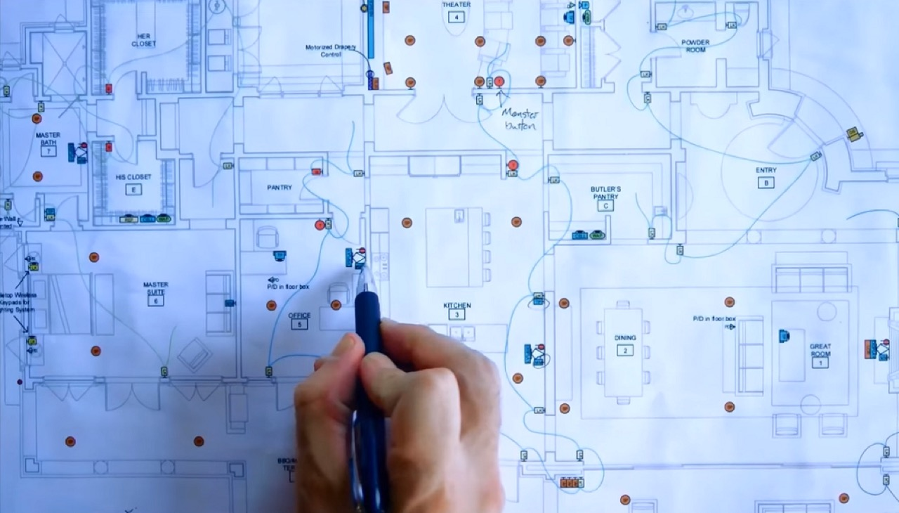 House plans with person making chnages with a pen